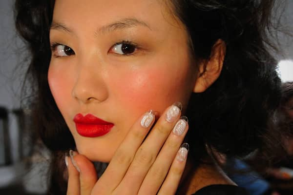 "Candice Manacchio of Creative Nail Design (CND) gave models ""lucite lace"" nails at the Joy Cioci spring 2012 show during Mercedes-Benz Fashion Week in New York. A lace effect is hand-painted on top of clear tips to achieve this look."