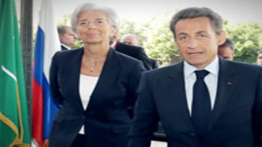 Christine Lagarde and French President Nicolas Sarkozy.