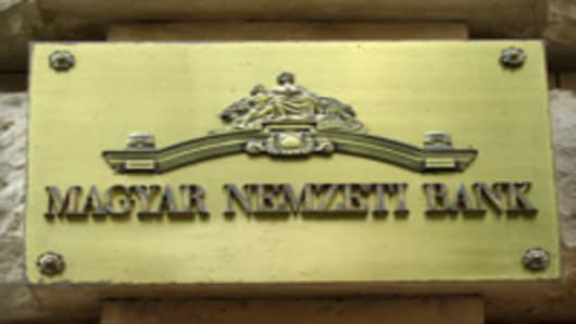 "A logo of Hungarian Natianal Bank (Magyar Nemzeti Bank, MNB) is seen on the wall of the MNB's headquarter in Budapest on July 19, 2010. Fruitless talks with the International Monetary Fund on access to a crucial loan package put pressure on the Hungarian forint, with analysts warning of further uncertainty in coming months. Economy Minister Gyorgy Matolcsy insisted however that the ""talks did not break down but they have been suspended. AFP PHOTO / ATTILA KISBENEDEK (Photo credit should read ATT"