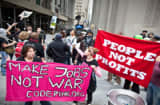 Demonstrators rally on Wall Street in lower Manhattan in New York, U.S., on Saturday, Sept. 17, 2011.
