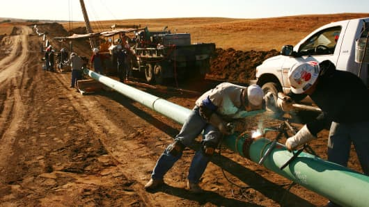 A crew from Alpha Oil & Gas Services Inc. constructs a 10 inch gas pipeline outside of Watford City, North Dakota, U.S
