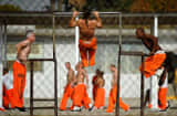 Inmates at Chino State Prison exercise in the yard December in Chino, Calif.