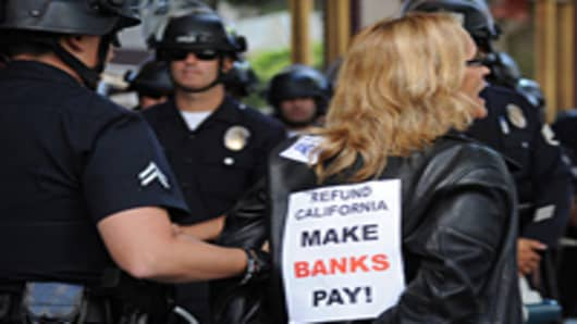 Occupy Wall Street protester being arrested in California