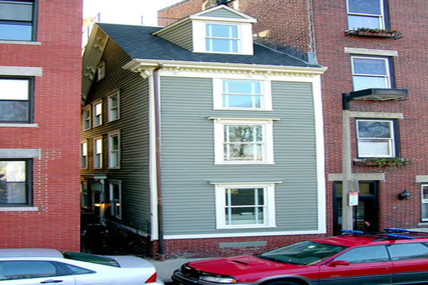 "Price: $345,000 in 2001Bedrooms: 2Bathrooms: 1Square Footage: 964The Skinny House in Boston's North End was built as a ""spite house"" during a family feud and is the narrowest house in Boston. At its most slender, the exterior is 9.25 feet, and the narrowest part of the interior is 6.2 feet, making it one of those properties where an adult can touch both walls from the center of the room.  The four-level Skinny House has no front door (it's entered from an alley) and the , but it still has more s"