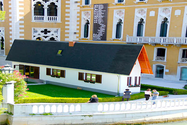 Price: $N/ABedrooms: N/ABathrooms: N/ASquare Footage: N/ANarrow Mist, a traveling art project by Austrian artist Erwin Wurm (pictured here in Venice) is modeled after the house he grew up in, only it's lost most of its width on a diet. The interior has narrow furniture, narrow bookshelves, a narrow landline telephone, narrow toilet and bathtub, and narrow rooms papered in 1970s patterns. Interior images can be found on the Design Boom .
