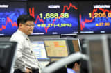 A trader monitors exchange rates in a dealing room at the Korea Exchange Bank in Seoul on October 4, 2011.