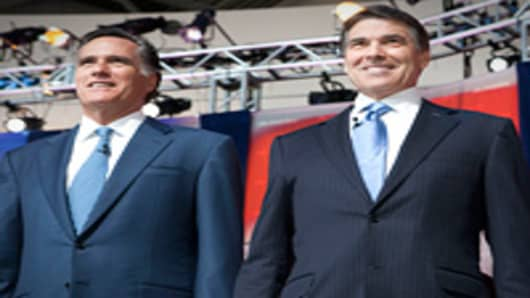 Republican presidential candidates (L-R) former Governor of Massachusetts Mitt Romney and Texas Governor Rick Perry