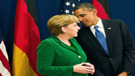 German Chancellor Angela Merkel and US President Barack Obama talk ahead of the start of the G20 Summit of Heads of State and Government on November 3, 2011 in Cannes, France.