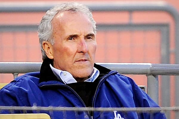 Frank McCourt is a former real estate developer who had always dreamed of owning a baseball team. He had tried unsuccessfully to purchase the Boston Red Sox, the Anaheim Angels, and the Tampa Bay Buccaneers, but in 2004 he fulfilled his dream and became owner of the Los Angeles Dodgers.In October 2009, he separated from Jamie McCourt, his wife of 30 years. This created some awkwardness, as she was CEO of the team. She was fired one week after the couple's separation was announced, and Jamie McCo