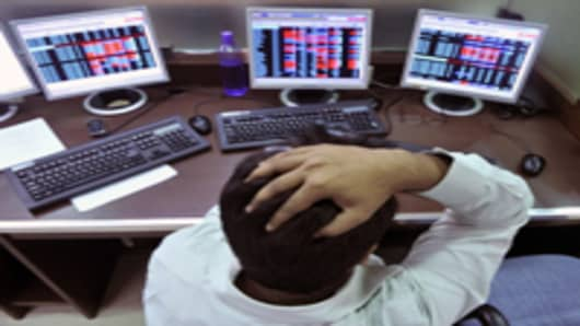 An Indian stockbroker reacts as he watches share prices on his computer during intraday trade at a brokerage firm in Mumbai.