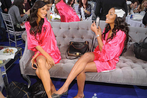 Models Lais Ribeiro (L) and Anais Mali (R) take photos backstage at the Lexington Avenue Armory in New York City.