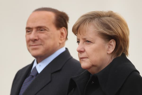 Arriving at a NATO summit in 2009, Berlusconi left the German Chancellor, Angela Merkel, waiting around for more than 15 minutes as he chatted on his mobile phone. As Merkel stood waiting to greet him on the red carpet, he waved her away and pointed to his phone. He then proceeded to turn and walk away to continue his conversation while she stood looking bemused. She finally opted to start the event's opening ceremony without the Italian leader.