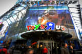 Pedestrians pass in front of a Toy &#039;R&#039; Us Inc. store in New York.