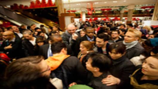 Bargain hunters shop for discounted merchandise at Macy's on 'Black Friday' on November 25, 2011 in New York City.