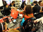 People make purchases inside Macy&#039;s department store November 25, 2011 in New York after the midnight opening to begin the &quot;Black Friday&quot; shopping weekend. AFP PHOTO/Stan HONDA (Photo credit should read STAN HONDA/AFP/Getty Images)