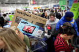 Customers shop for electronics items during &#039;Black Friday&#039; at a Best Buy store in San Diego, California.