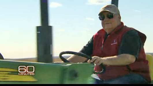 Howard Buffett drives a piece of farm equipment in this frame grab from a profile of Warren Buffett's son on CBS' 60 Minutes.