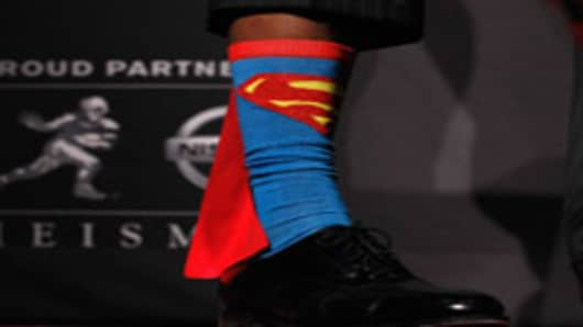A detail view of Heisman Memorial Trophy Award winner Robert Griffin III of the Baylor Bears showing his Superman socks during a press conference at The New York Marriott Marquis.