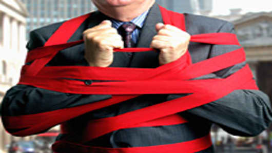 man-wrapped-red-tape-200.jpg