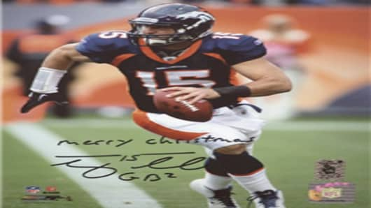 "Tim Tebow Autographed Denver Broncos (Blue Jersey) with ""Merry Christmas"""