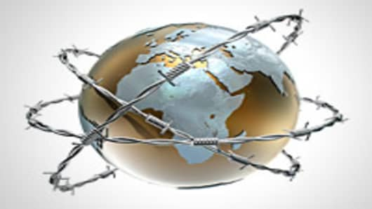 Globe wrapped in barbed wire