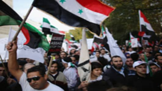 Protesters Gather At Syrian Embassy In London