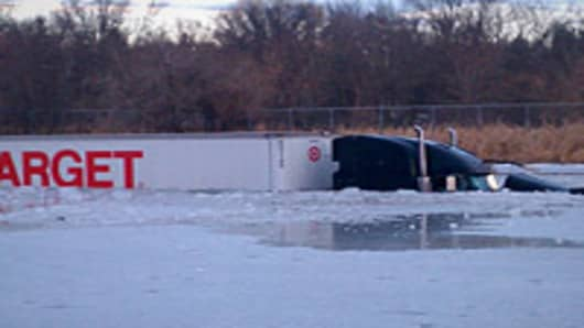 Target Semi-truck went off I-94 near Monticello into icy pond.