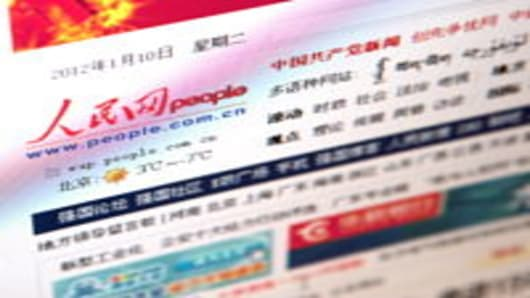 The People's Daily Online Co. Ltd. website is displayed on a computer in Beijing, China, on Tuesday, Jan. 10, 2012. People's Daily Online Co., which operates the website People.com.cn, plans to sell 69 million shares in an initial public offering in Shanghai, according to a prospectus published on the China Securities Regulatory Commission's website.