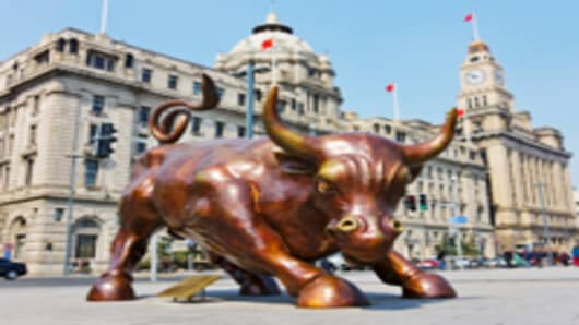 Bull statue symbolizing the stock market on the Bund, Shanghai, China.