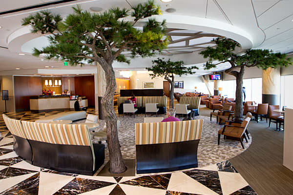 Located in San Francisco International's terminal 2, the club lounge stands out for its amenities and commitment to green energy. Opened in April 2011, the Admirals Club is LEED certified – referring to a rating system that promotes sustainable building practices. The club's lounge also was designed to reflect its location in the San Francisco Bay Area, rich in Asian culture and iconic landmarks. Bamboo wood accents the walls. Golden Gate Park has been recreated inside the lounge. Scenery aside,