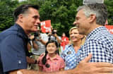 Republican Presidential Candidates Romney and Huntsman Campaign In New Hampshire