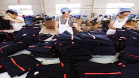 Labors work at a clothing factory on August 1, 2011 in Huaibei, Anhui Province of China.