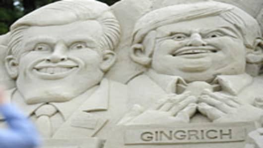 A sand sculpture picturing Republican presidential hopefuls (L-R) Mitt Romney and Newt Gingritch is set in front of the Myrtle Beach Convention Center ahead of a Republican debate in Myrtle Beach, South Carolina, on January 16, 2012