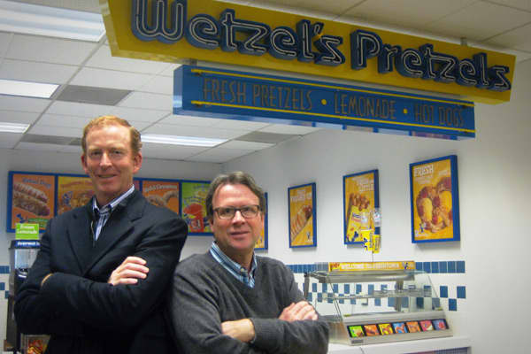 Rick Wetzel and Bill Phelps were working for Nestle when the concept for Wetzel's Pretzels was born. The two were on a business trip when Wetzel told Phelps about an idea his wife had—to make big, soft pretzels to sell at the mall. That night, they sat at a bar and drew out their business plan on napkin.Wetzel sold his Harley Davidson to help raise funds for the fledgling business, which they started in their spare time. They brought in a partner to help create the recipe in Phelps' kitchen, and