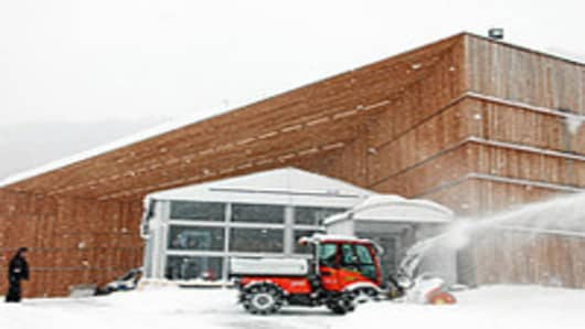 Clearing the snow in front of the main entrance of the Davos Congress Centre, venue of the upcoming Annual Meeting 2012 of the World Economic Forum in Davos, Switzerland, January 22, 2012.
