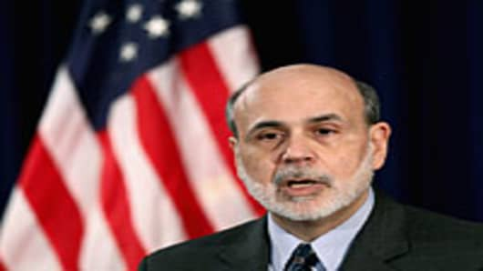 Federal Reserve Chairman Ben Bernanke speaks during a press conference announcing that the Fed will take no action on interest rates at the Federal Reserve Bank on January 25, 2012 in Washington, DC