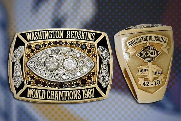 """Value: $40,000 Team: 1987 Washington Redskins The ring shown here belonged to defensive lineman Dexter Manley, who played for the Washington Redskins in its 42-10 Super Bowl win over the Denver Broncos in San Diego, Calif. Manley, nicknamed the """"Secretary of Defense,"""" is considered an all-time great, but battled drug addiction and eventually served two years in jail on a cocaine conviction. Manley later revealed that he was functionally illiterate, despite having studied at Oklahoma State Univer"""