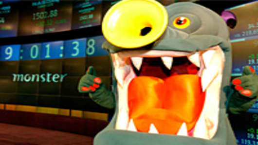 The mascot and symbol for Monster Worldwide stands in front of the NASDAQ Market Board at  in New York City.