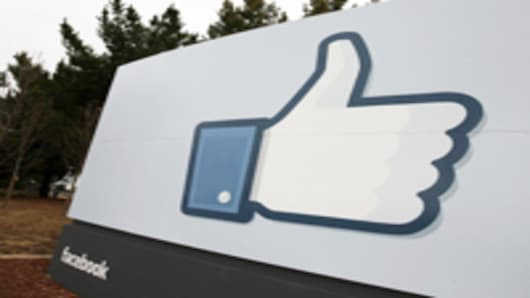 A sign with the 'like' symbol stands in front of the Facebook headquarters in Menlo Park, California.