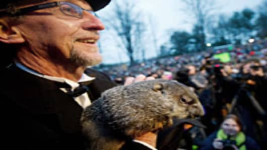 Groundhog handler Ron Ploucha holds Punxsutawney Phil after he saw his shadow predicting 6 more weeks of winter during the 126th annual Groundhog Day festivities on February 2, 2012 in Punxsutawney, Pennsylvania.