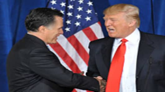Businessman Donald Trump shakes hands with Republican presidential hopeful Mitt Romney after announcing his endorsement of Romney at Trump International Hotel & Tower on February 2, 2012 in Las Vegas.