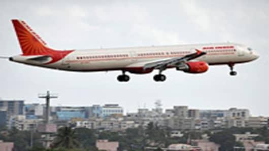 An Air India aircraft prepares to land at the international airport in Mumbai
