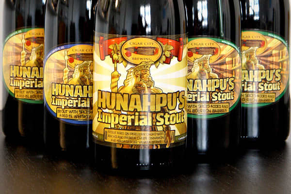 Brewed by Cigar City BrewingStyle: Imperial StoutOrigin: Tampa, Florida USACigar City Brewing aims to use fresh and local ingredients that reflect the culture and heritage of Tampa Bay. In Mayan myth, Hunahpu gave the gift of cocoa to the Mayan people, thus making it an appropriate name for this beer that is said to taste of chocolate, vanilla and spice. The base recipe is Cigar City's Marshal Zhukov Imperial Stout. However Hunahpu is a richer version aged on pasilla and ancho peppers as well as