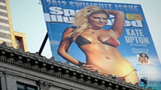 The 2012 Sports Illustrated Swimsuit Issue billboard is unveiled in New York's Times Square.