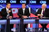 Republican presidential candidates Rick Santorum, Mitt Romney and Newt Gingrich participate in a debate sponsored by CNN and the Republican Party of Arizona at the Mesa Arts Center February 22, 2012 in Mesa, Arizona.