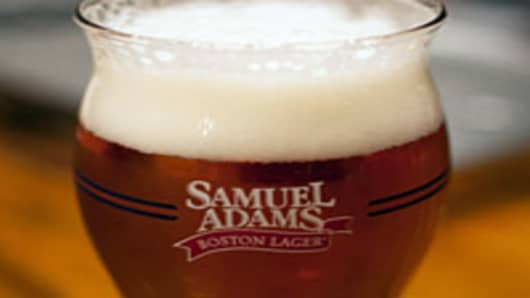 A pint of Sam Adams Boston Lager sits on a table inside the tasting room at the Boston Beer Co.'s Samuel Adams Brewery in Boston, Massachusetts.
