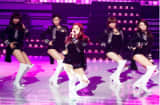 South Korean girl group Nine Muses (9 Muses) performs on stage.