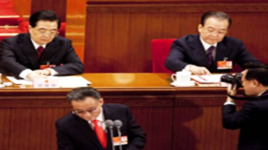 Hu Jintao, China's president (L) and Wen Jiabao, China's prime minister (R) and Wu Bangguo, chairman of the National People's Congress (NPC), attend the National Party Congress in 2011.