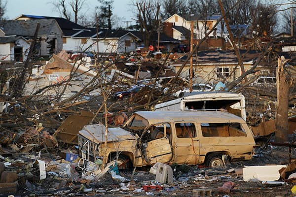 Vehicles and other possessions are scattered after a tornado ripped through a neighborhood in the early morning hours of February, 29, 2012 in Harrisburg, Illinois.
