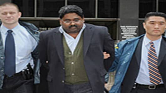Raj Rajaratnam, billionaire founder of the Galleon Group hedge fund, is led from FBI headquarters after being charged with alleged insider trading, New York City.